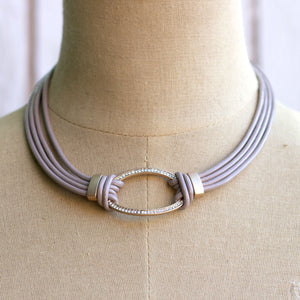 leather strip with oval necklace