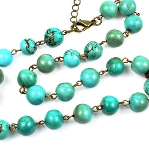 turquoise beads + yellow cross
