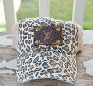 << Repurposed LV Patch on Blonde Leopard Hat