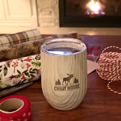 Jack Pine Boathouse tumbler with Christmas wrapping supplies