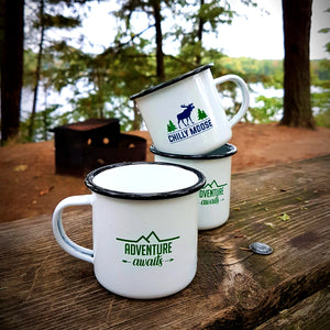 Adventure Awaits Enamel camping mugs stacked on wood picnic table