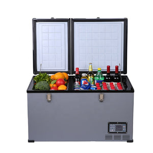 Front view of the Chilly Moose Big Buck 80L Portable Fridge-Freezer open and filled with a variety of beverages, fruits and vegetables on a white background.