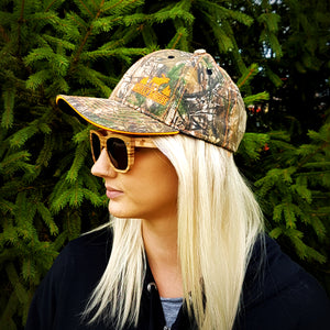 Blonde girl wearing Antler Cap and Hardwood Sunnies in Granite
