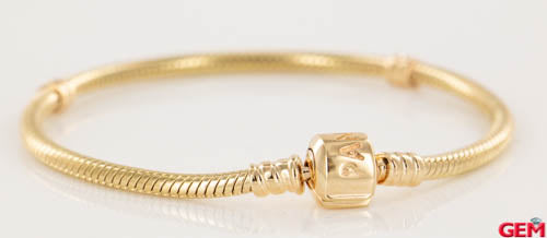 Pandora Solid Yellow Gold 14k 585 ALE 7.1 inches 18cm Moments Charm Bracelet - Pre-Owned for sale at Gem Pawn