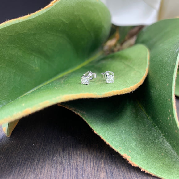 .04ct White Gold Diamond Stud Earrings