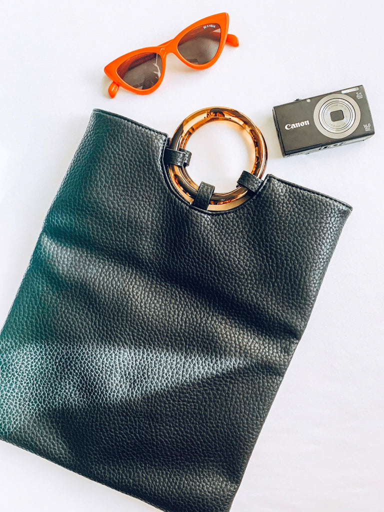 black faux leather fold over clutch