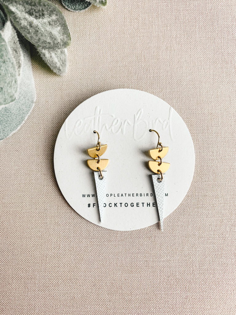 leather and gold earrings white