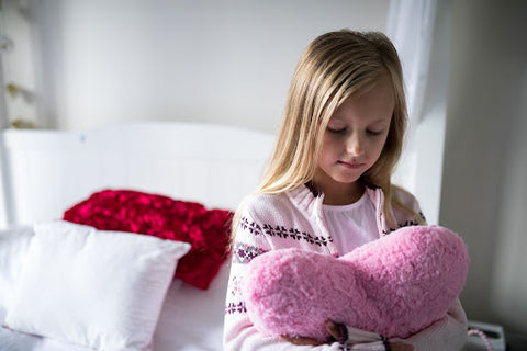 girl-with-heart-pillow