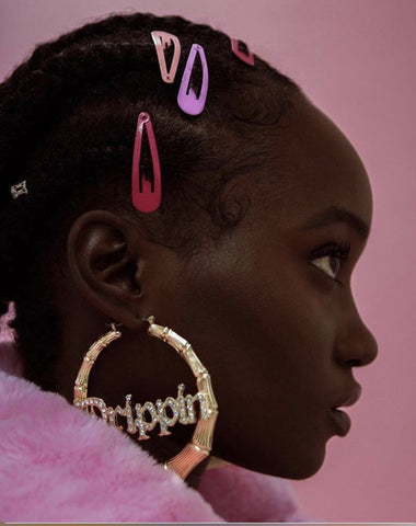 black girl wearing gold hoops