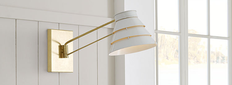 Swing arm sconce in the bathroom