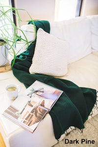 Ethically and sustainably handmade in Nepal, beautiful soft blanket to keep you warm and cozy. Use it as a colourful throw on a bed or snuggle into it while relaxing. It is big enough to take it to the footy. Janicka (Janicka.com.au). Dark Pine