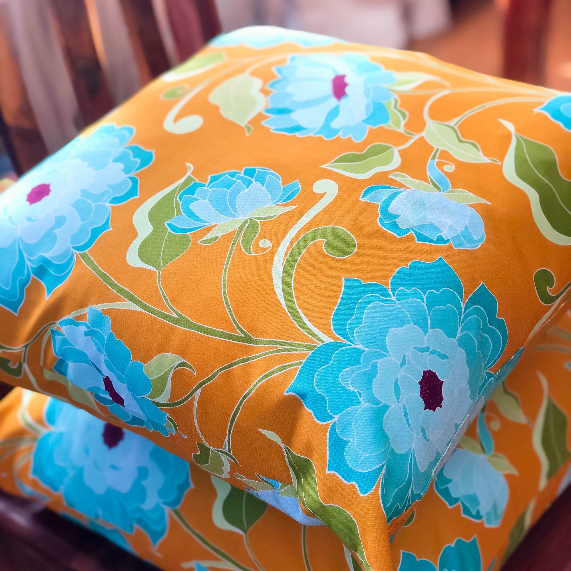 Handmade cushion - turquoise roses on saffron yellow cushion -