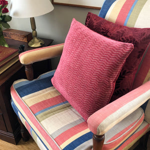 Pink cushion on striped armchair by The Cushion Ninja