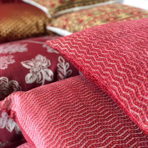 Red and pink cushions by The Cushion Ninja