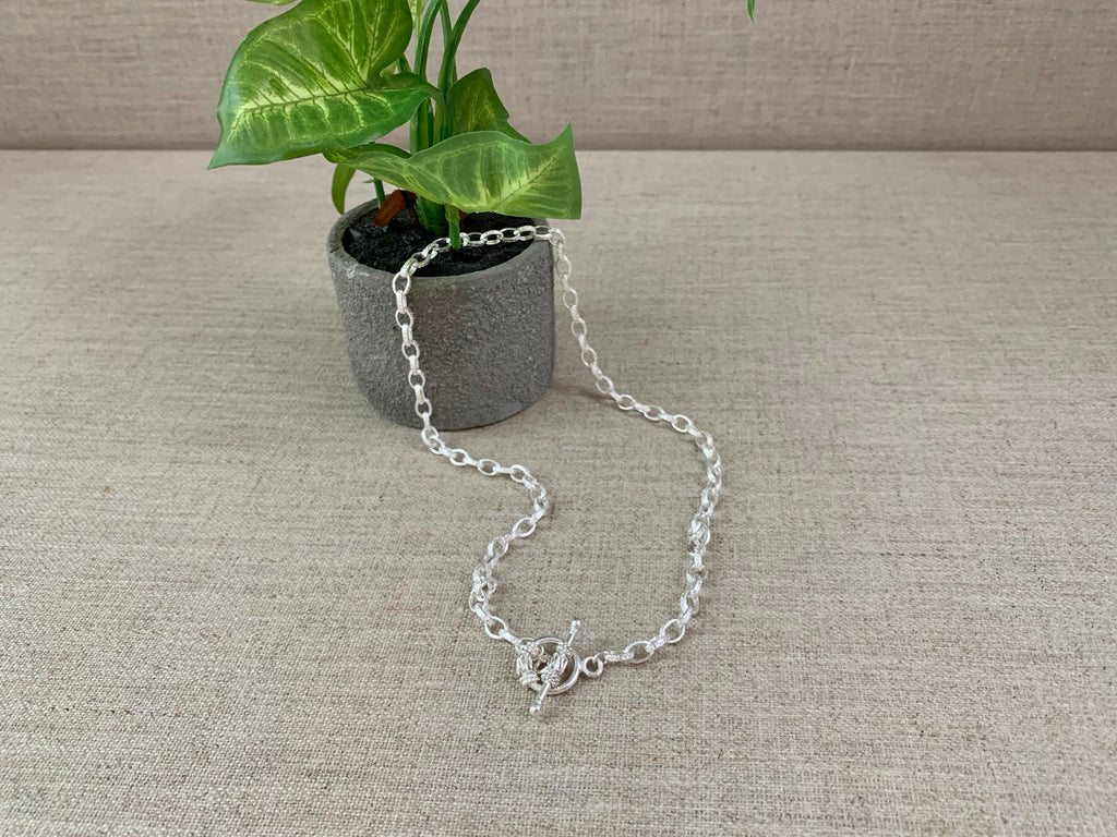 Don't Let Me Go Necklace in Silver