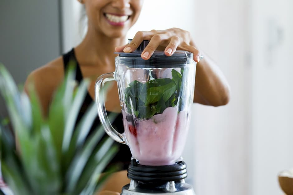 woman blending smoothie