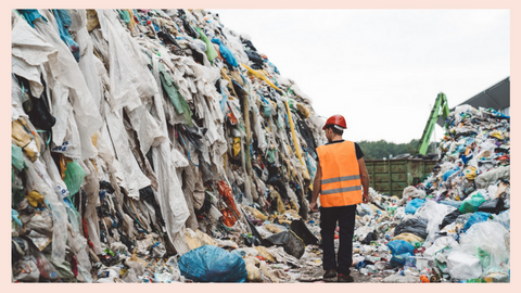Image of a construction worker in front of a landfill of textile waste from fast fashion brands