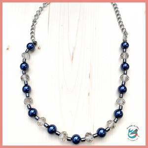 handmade necklace featuring navy blue faux pearls and upcycled faceted glass beads. semi precious hematite beads received through jewelry upcycling donations