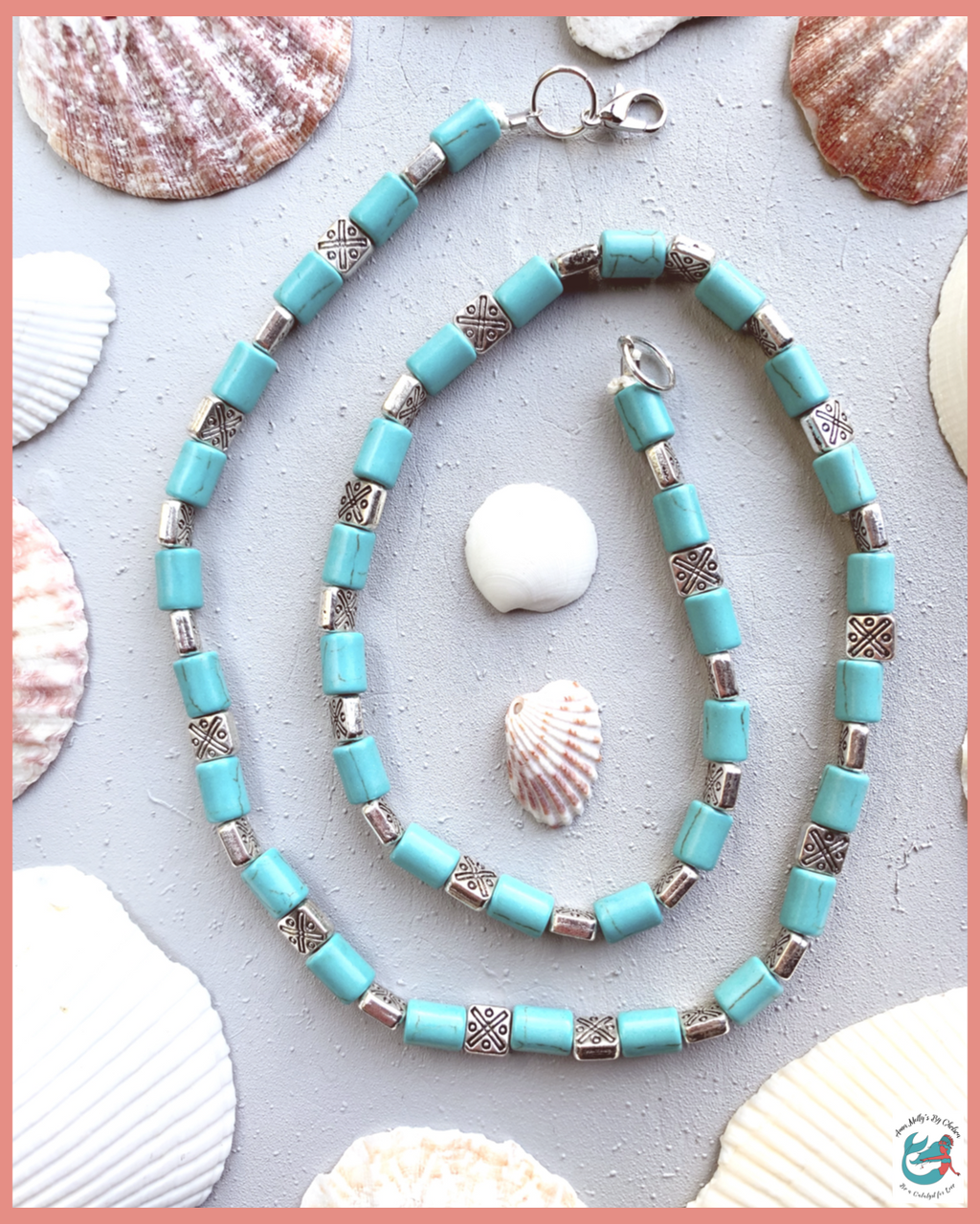 Image shows a turquoise and silver beaded necklace on a grey desk with seashells. This boho western style necklace is handmade using upcycled materials. More slow fashion ethical jewelry available to shop at www.annamollysbychelsea.com