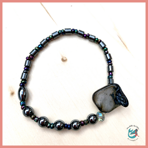 stretchy seashell bracelet with upcycled hematite and sustainably sourced seashells