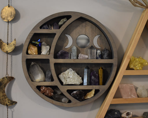 Grey Circular Moon Shelf and Wood Carving