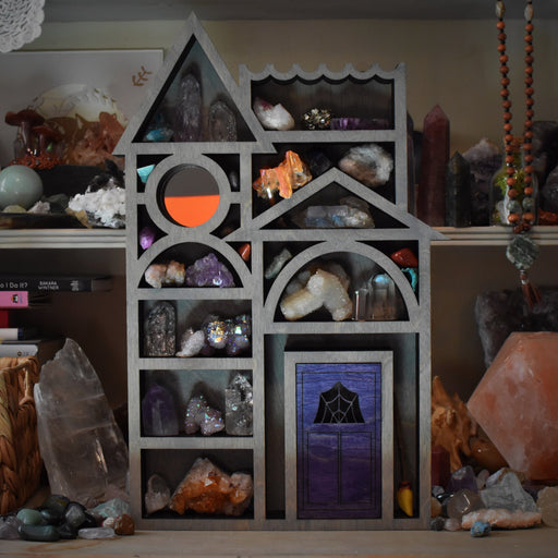 Grey Storybook House Shelf and Wood Carving