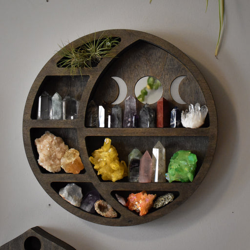 Brown Circular Moon Shelf and Wood Carving