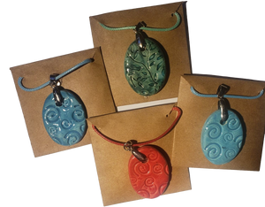 "Jewelry Necklace Set Embossed Clay Pendant Hand-Crafted Oval Shaped Various Designs 2""H"