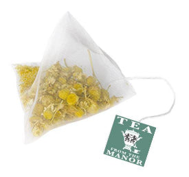 Camomile flower teabag with string and Tea From The Manor label
