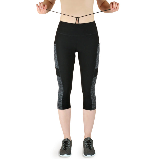 Variosports® Fitness Sport-Capri 3/4 Leggings mit 3 Seitentaschen für Handy etc., grey-black