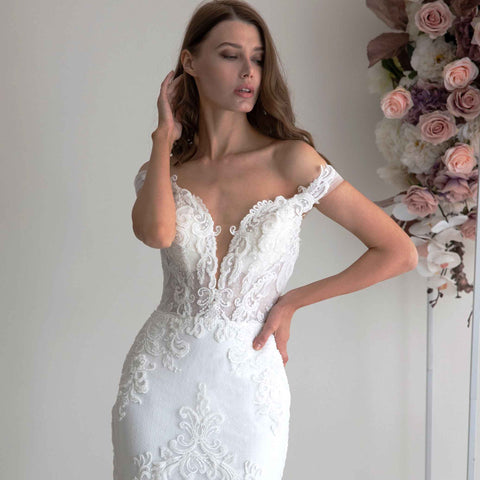 Plunging V off-shoulder lace gown