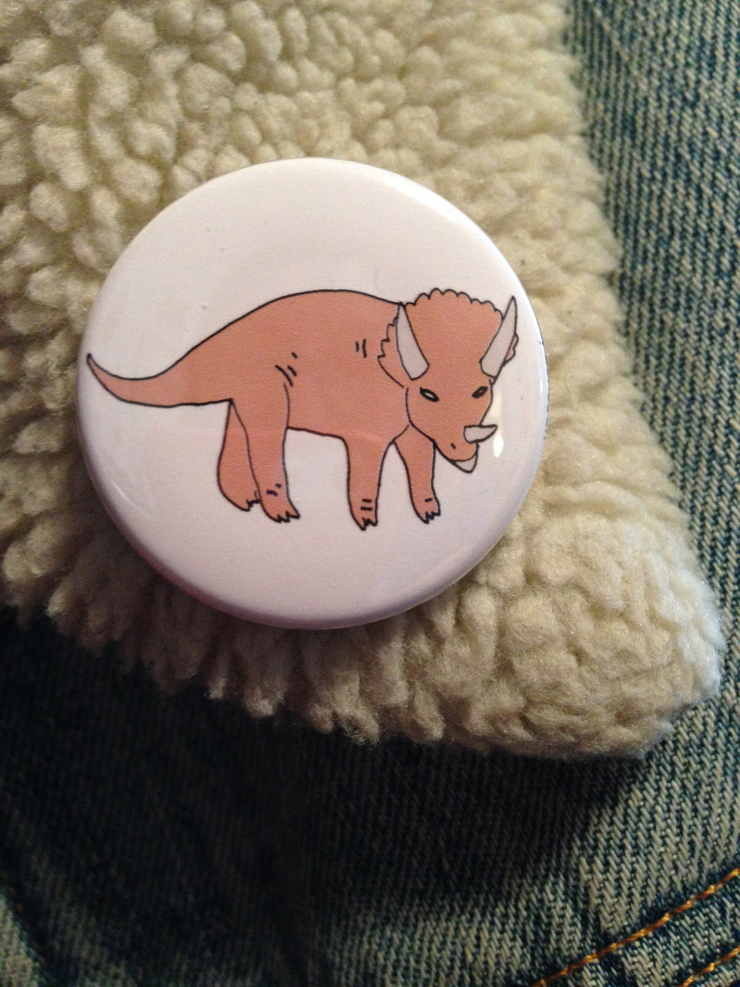 TRICERATOPS badge
