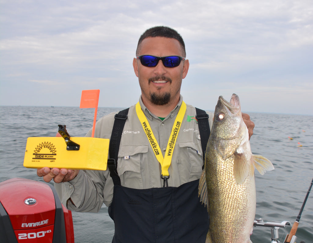 "<p class=""p1"">Charter captain Terry Kunnen rigs his in-line boards with after market releases designed to function with hard to hold fused lines and super braids. The advancements of new and unique line releases and clips has allowed anglers to use in-line boards for an ever growing number of Great Lakes trolling niches. </p> <p class=""p2""> </p>"