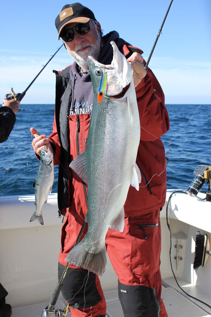 """Author with a brace of """"sublime to ridiculous"""" steelhead taken on top while working other lines deep. Deep currents get the water moving just under the surface, too—and steelhead like it."""