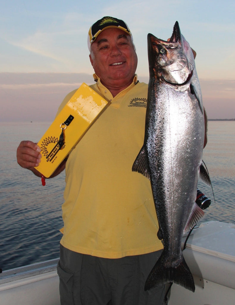Bruce DeShano of Off Shore Tackle holds a nice Lake Michigan king salmon caught fishing sinking lines in cooperation with the SST Pro Mag board. Larger boards like this are gaining in popularity among anglers who fish longer and longer lengths of lead core, copper line and the new Weighted Steel wire.