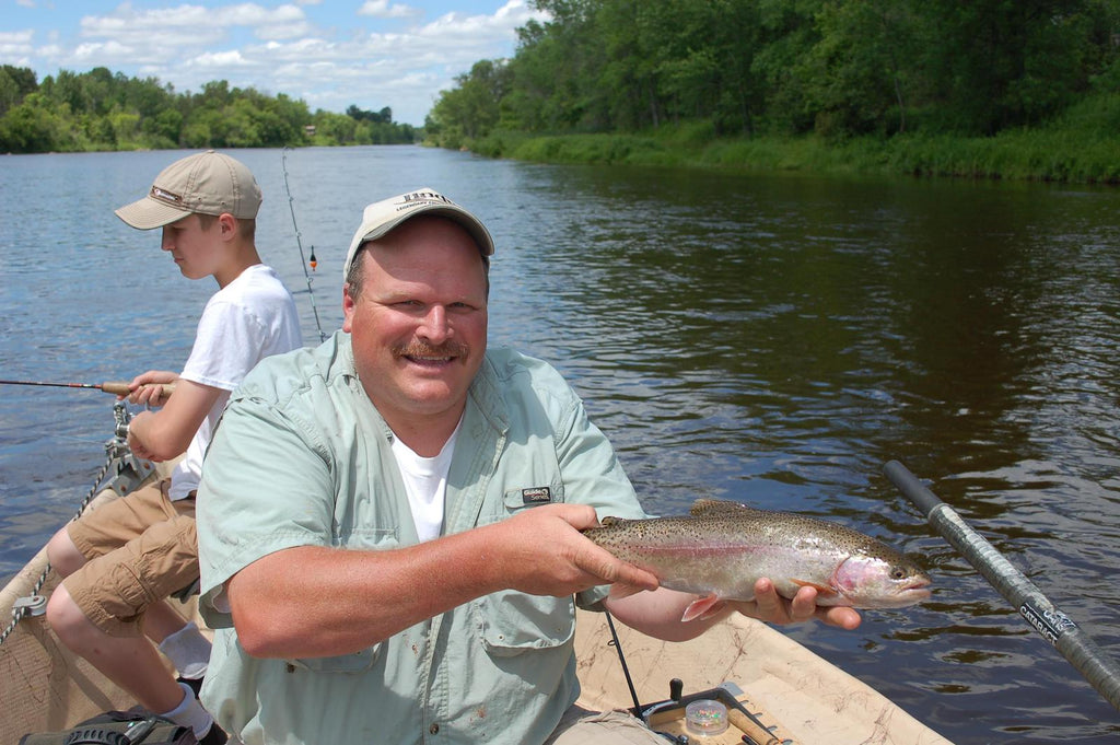Denny Bouwens shows off a Muskegon River rainbow trout.