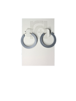 Load image into Gallery viewer, On a white R+D earring card are two chunky hoops. They are printed in an eco friendly silver color.
