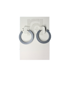 On a white R+D earring card are two chunky hoops. They are printed in an eco friendly silver color.