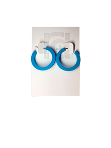 On a white R+D earring card are two chunky hoops. They are printed in an eco friendly teal color.