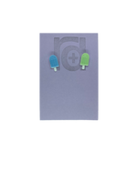 Load image into Gallery viewer, Two small and detailed R+D earrings are shown on a purple earring card. They are shaped as popsicles with white sticks. The earrings are mismatched, one popsicle is light blue and one is light mint green.