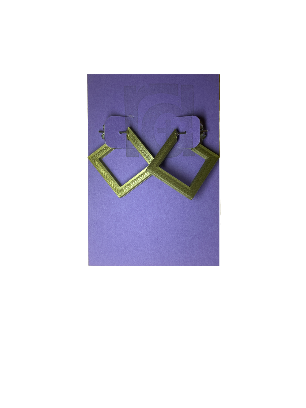 On a bight purple R+D card are two 3D printed earrings. They are hoops that are in the shape of squares. These are printed in a shiny gold.