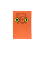 Load image into Gallery viewer, On a orange earring tag are two small and detailed  R+D studs. They are  shaped as sunflowers with black centers and bright yellow petals all around.
