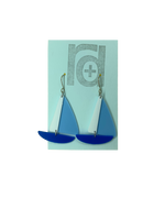 Load image into Gallery viewer, On a light blue earring card are two R+D earrings. They are shaped as sailboats with three pieces: A thin white sail, and larger light blue sail and a classic cobalt blue hull.