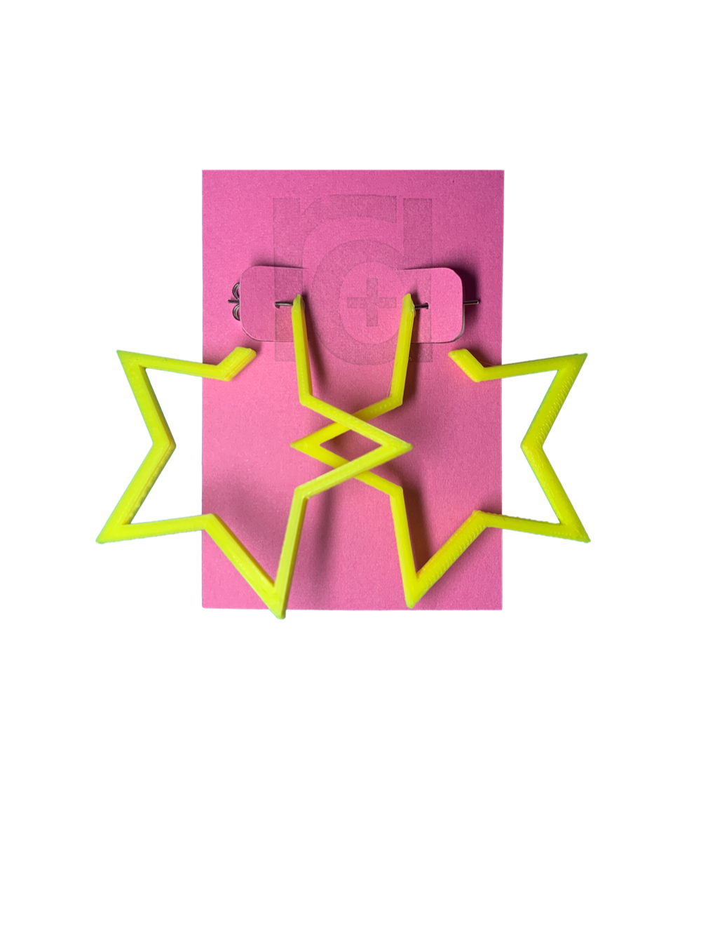 On a bright pink card are two R+D earrings. The earrings are yellow star hoops that are 3D printed with a plant based filament.