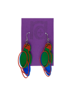 Load image into Gallery viewer, Hanging from a bright purple earring card are two R+D 3D printed earrings. The earrings each have three pieces that form a parrot shape that is red, green, and blue.