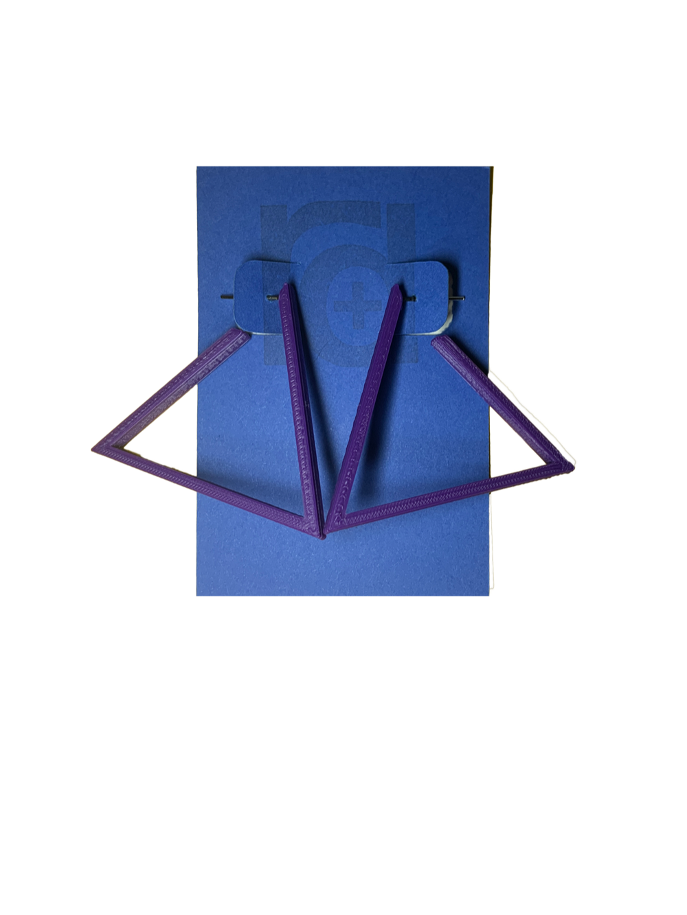 Hanging off of a blue R+D earring card are two 3D printed earrings. They are hoops that are in the shape of a triangle. These earrings are printed in a eco friendly purple.