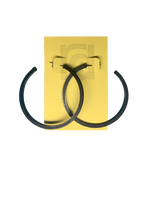 Load image into Gallery viewer, Shown on a yellow R+D card are two 3D printed hoop earrings. They are large two inch hoops in a black that are lightweight and plant based.