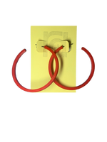Load image into Gallery viewer, Shown on a yellow R+D card are two 3D printed hoop earrings. They are large two inch hoops in a bright red that are lightweight and plant based.