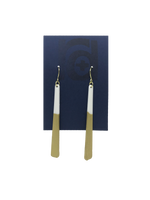 Load image into Gallery viewer, Shown on a sustainable dark blue earring card, these earrings are long dangles that flare out slightly. The white plant based earring is dipped into metallic gold paint to give a perfect shimmering accent.