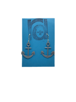 Load image into Gallery viewer, Two earrings hang on a blue earring card. The earrings are 3D printed in a plant based silver filament. They are shaped like anchors.